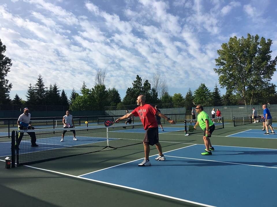 Participants playing pickleball at the outdoor pickleball courts.